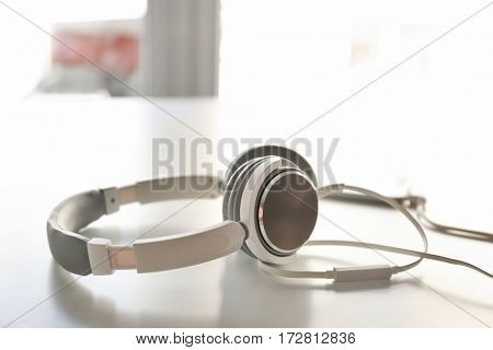 Headphones on table and blurred background