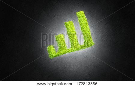 Green growing graph as symbol of progress and income.