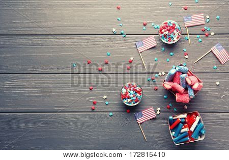 Assortment of sweets with USA flags on wooden background