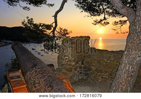 Sunset in the medieval walled town Vila Vella  in Tossa de Mar.