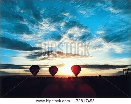 Air Balloons in yellow field during sunset. Colorful air balloons on sunset sky background. Autumn festival of air balloons. Yellow air balloon for flight. Beautiful fall landscape. Bright blue sky