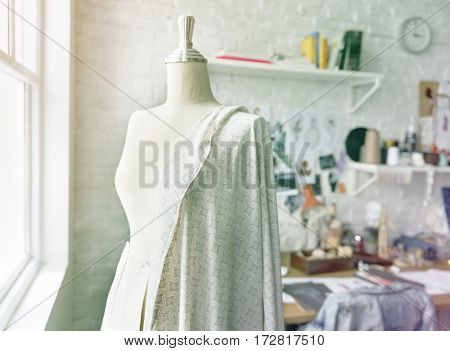 Mannequin and dressmaking objects on the workshop room