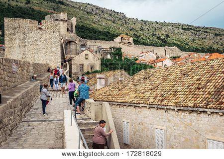 Dubrovnik, Croatia - June 13, 2016: Tourists Visiting The Famous Dubrovnik City Walls That Surround