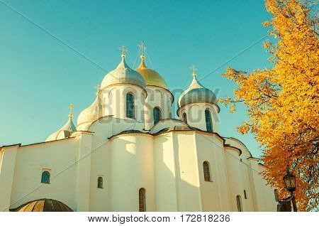 Architecture landscape of St Sophia Cathedral domes in Veliky Novgorod Russia in autumn sunset. Vintage tones processing. Architecture landmark of Veliky Novgorod, Russia
