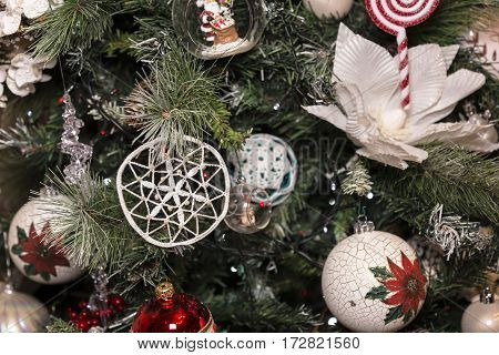 Christmas decorative hook with white stars, white flower and sweet on christmas tree