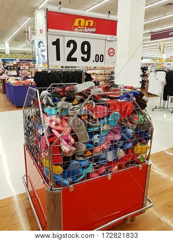 CHIANG RAI THAILAND - FEBRUARY 15 : various brand of discount toe post sandals for sale on supermarket stand or shelf on February 15 2017 in Chiang rai Thailand.