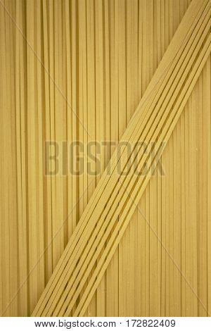 Thin Pasta Arranged In Rows. Yellow Italian Pasta. Long Spaghetti. . Thin Spaghetti. Food Background
