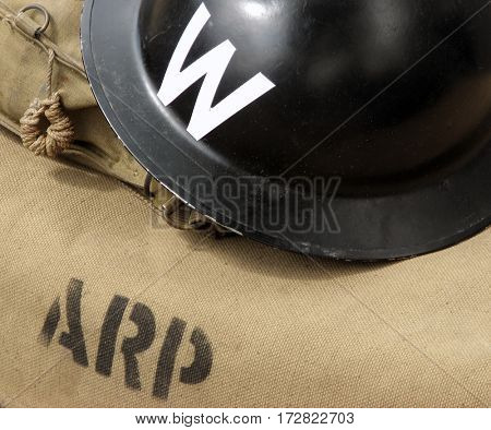 Air raid wardens helmet on canvas bag.