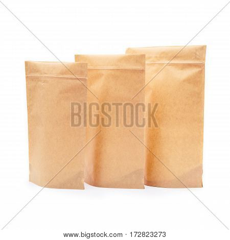 Three Brown Kraft Paper Bags. Blank Side Gusset Foil Coffee Bags Isolated on White Background. Packaging Template Mockup Collection. Clipping Path. Aluminium coffee package. Block Bottom Pouch