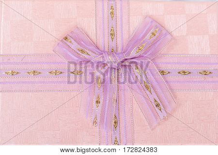 Pink Bow Over Pink Box. Flat Lay Perspective.