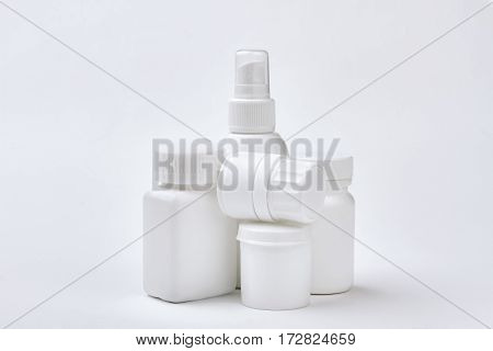 White medical containers set isolated. Plastic remedy boxes. Precaution of illnesses.