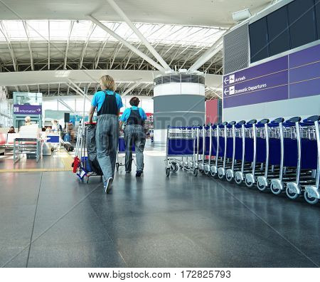 Woman with cleaning instrument in airport