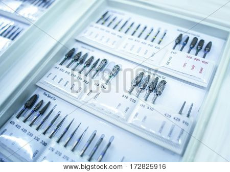 Set of dental borers on white stand