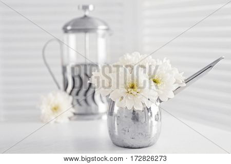 Bouquet of beautiful flowers in jug on  table