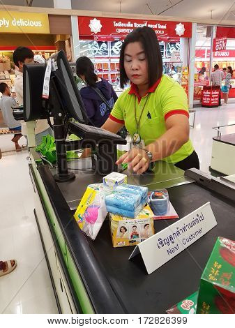 CHIANG RAI THAILAND - FEBRUARY 15 : female seller cashier using barcode scanner in supermarket on February 15 2017 in Chiang rai Thailand.