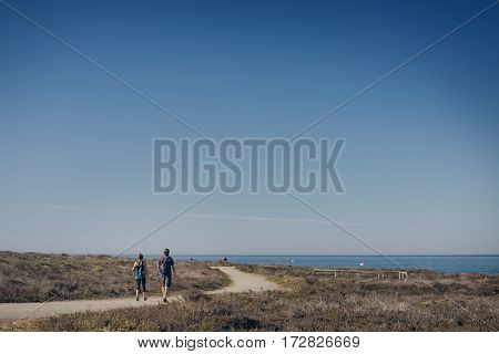 Hikers on the pathway at sunny day