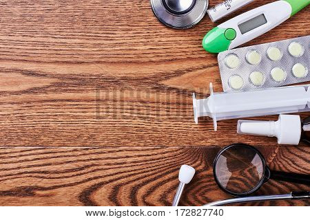 Thermometer, stethoscope, syringe and loupe. Medical instruments and aids. Check your health.