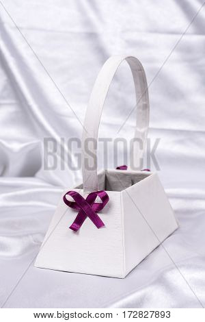 Purple Bow On White Flower Box On The White Satin. Beautiful Wed