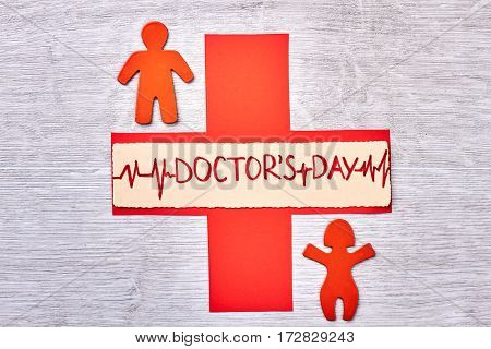 Red stickmen and cross. Happy Doctor's Day to you.
