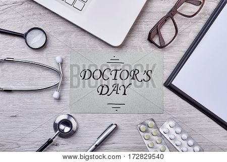 Folder, glasses, loupe and stethoscope. Sincere congratulation for your doctor.