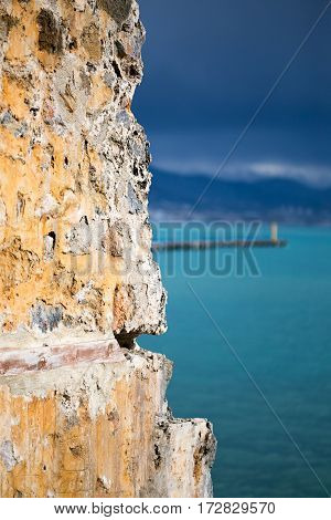 Old Stone Wall In Focus And Turquoise Sea