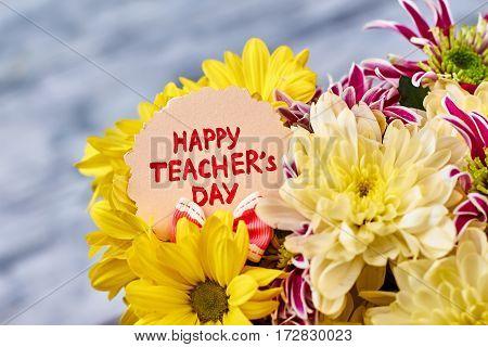 Bouquet of golden chrysanthemums. Celebration of Teacher's Day.