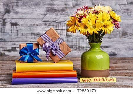Flowers, vase and gift boxes. Beautiful autumn present for Teacher.