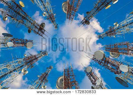 Mobile Phone Communication Antenna Tower With Cloud On Center Blue Sky.