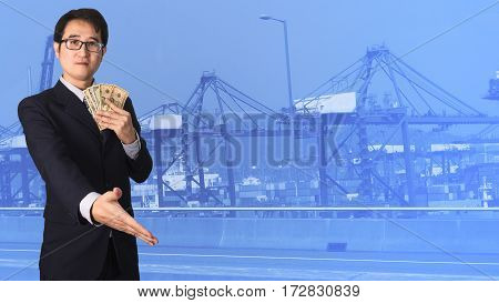 Double Exposure Businessman Shaking Hand On Blurred Port Cargo Crane Container Background.