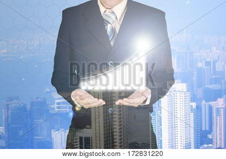 Double Exposure Of Business Growth Financial Graph Chart With Arrow On Businessman Hand, Building Ba