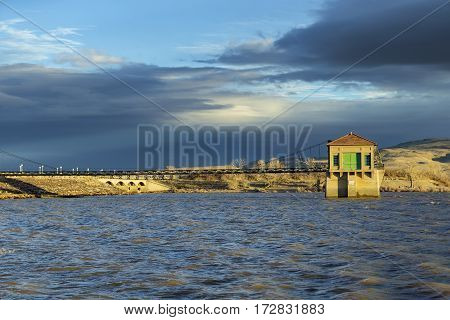 Flood control building at full reservoir at Sunset.  Lake Lahontan.  Shallow Depth of Field with focus on flood control tower.