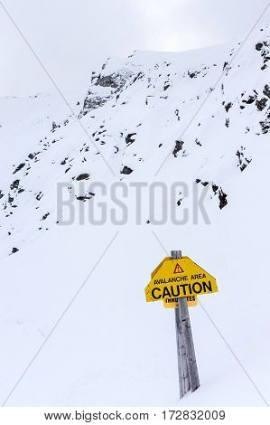 Avalanche Warning Sign On Whitehorn Mountain In Lake Louise