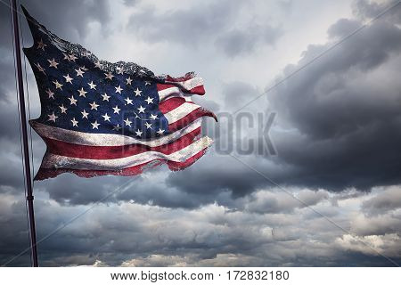 ripped tear grunge old closeup of american USA flag, stars and stripes, united states of america on cloudy sky, dark mystery style atmosphere