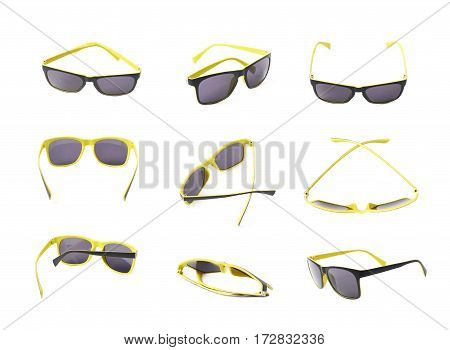 Pair of yellow plastic sunglasses with the dark shades, composition isolated over the white background, set of nine different foreshortenings