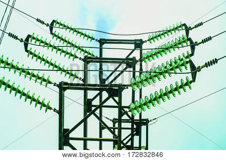 Electric wires and insulators against the sky