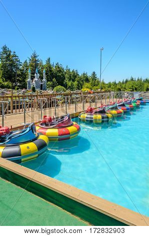 Bumper boats at amusement park at sunny day in summer.
