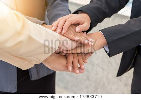 Business People Joining Hands Success Teamwork and Partnership Concept.