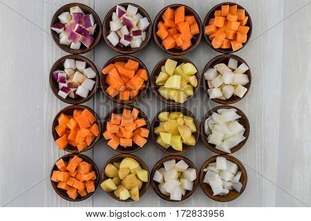 Sixteen Bowls of Root Vegetables in Color Order