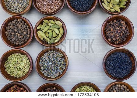 Spices in Bowls with Two Spaces Empty