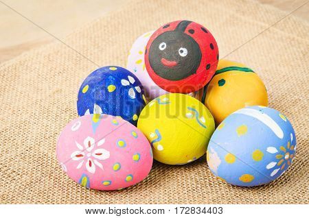 The Colorful easter eggs on sack background.