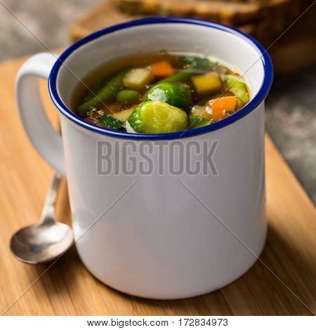 Vegan vegetable soup with brussels sprouts carrots peas and beans.