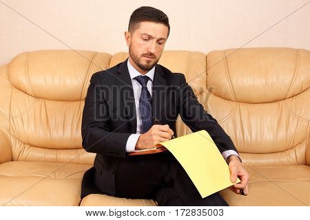 the a young businessman working with documents