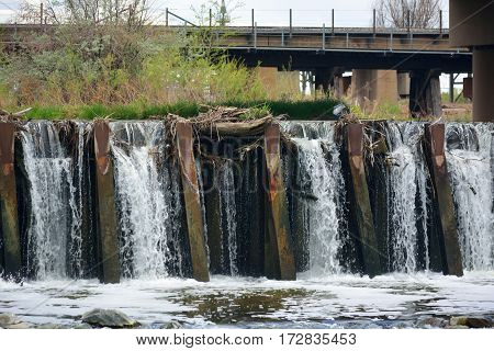 Urban River Metal Dam Water Flow with Blockages