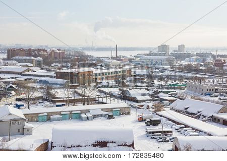 Skyline of winter snow industrial city in Russia, wide angle