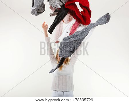 Woman Throwing Big Pile Of Clothing