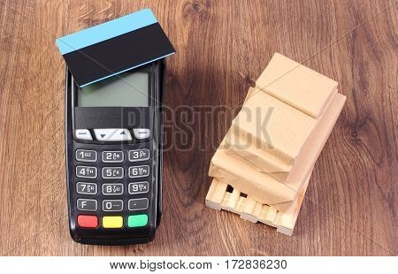 Payment Terminal With Credit Card And Wrapped Boxes On Wooden Pallet, Paying For Products And Shippi