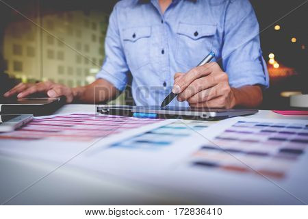 Creative Businessman Or Designer Writing On Graphic Tablet While Using Laptop In Office