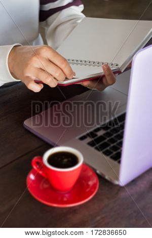 Woman looking at note paper stock photo