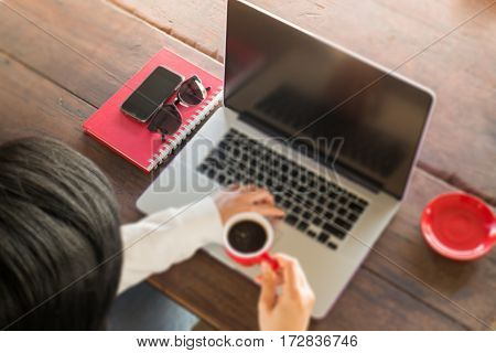 Hand on red cup of espresso stock photo