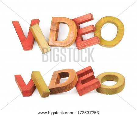 Word Video made of colored with paint wooden letters, composition isolated over the white background, set of two different foreshortenings